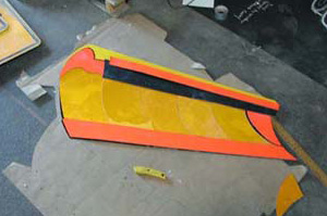The finished snowplow blade whihc utilizes reflective vs no reflective signs to create visual depth