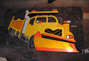 The truck body is mostly laid out on the tar paper with the exception of the silver highlights and the under carrage.