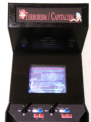close up on the front of the arcade cabinent showing a title screen and some of the player controls.