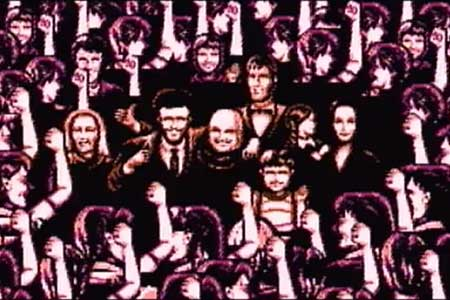 This scene takes place shortly after blowing up the UFO.  The adams family are in the middle of cheering people who are throwing their fists into the air in celebration.